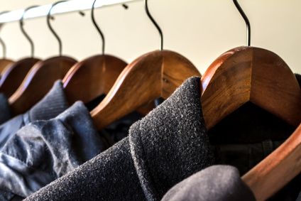 Winter clothes hanged on a clothes rack